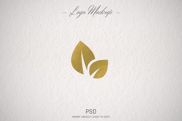 Golden logo mockup on paper