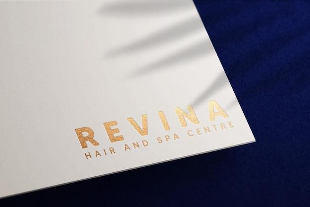 Golden logo mockup on white paper