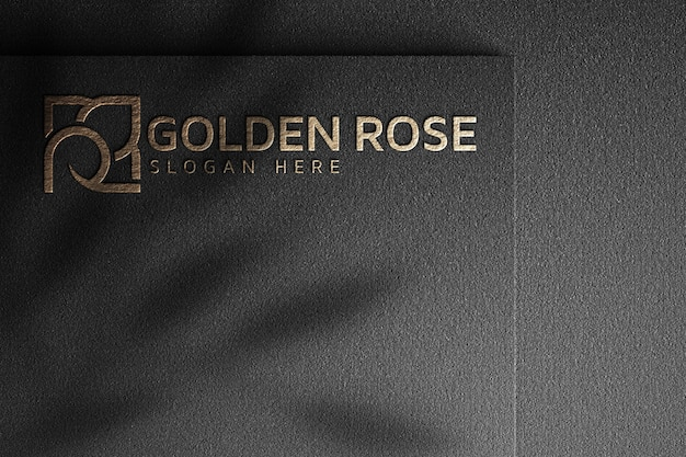 어두운 종이에 황금 장미 로고 모형