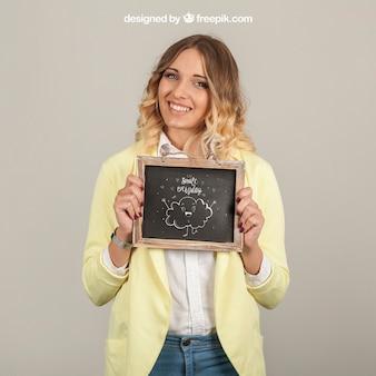 Good looking woman holding slate