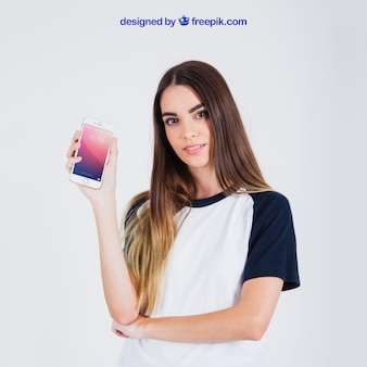 Good looking woman holding smartphone