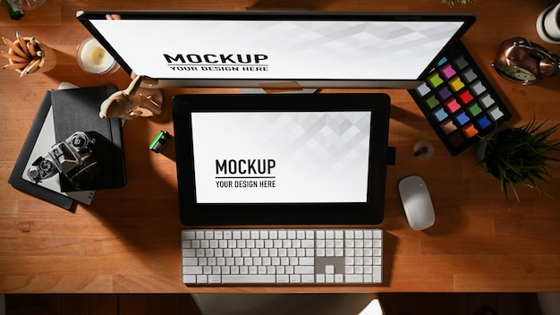 Graphic designer workspace with tablet, computer, camera and tools mockups