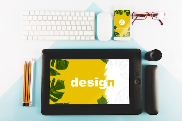 Graphic tablet mockup and various technological devices