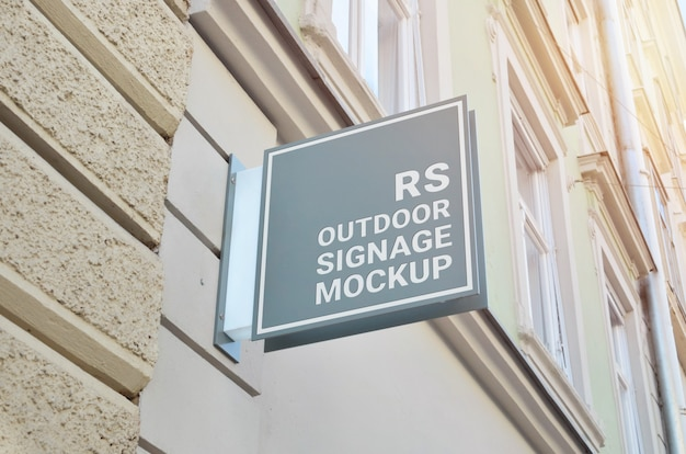 Gray square sign, logo mockup on building wall