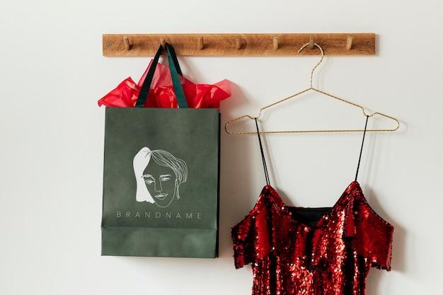 Green feminine bag mockup on a wall hanger