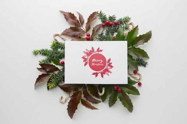 Green leaves and mock-up festive christmas decorations