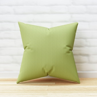 Green pillow and square shape on wood floor and white brick wall background with blank template. pillow mockup for design. 3d rendering.
