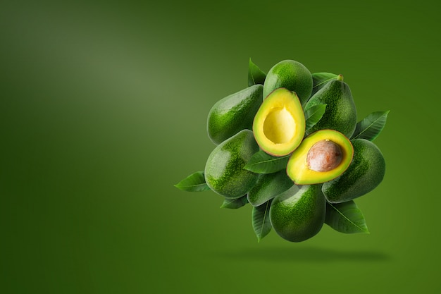 Green ripe avocado isolated on green.