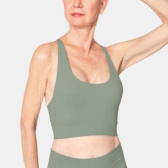 Green sports bra mockup psd senior women's sportswear close up