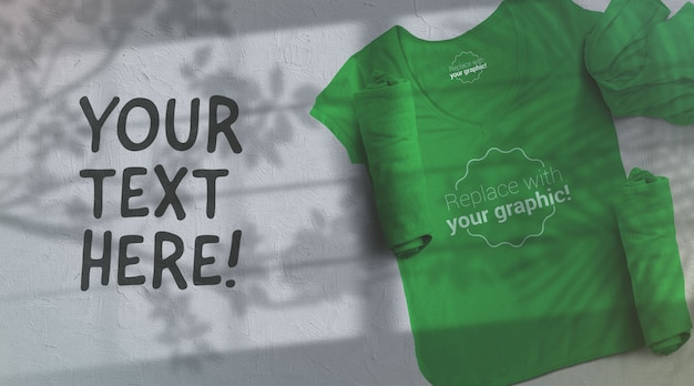 Green t-shirt mockup on light gray background sunglight shadows