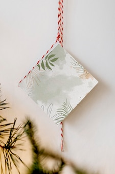 Greenery card hanging by the wall