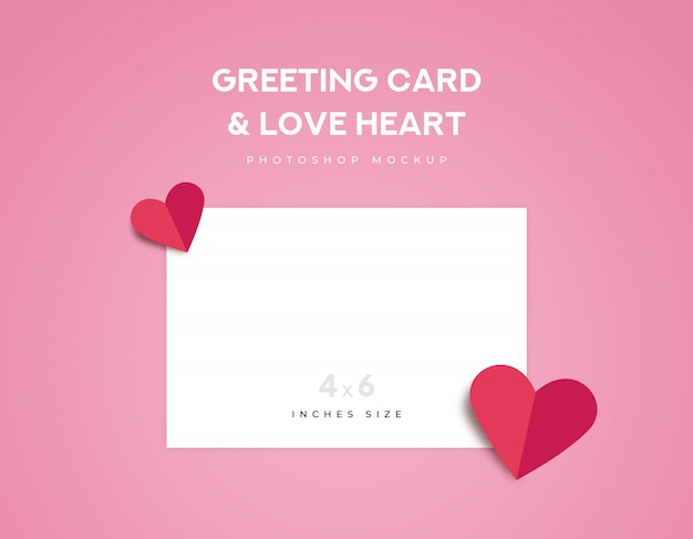 Greeting card 4x6 inches size and two red love heart origami fold on pink background