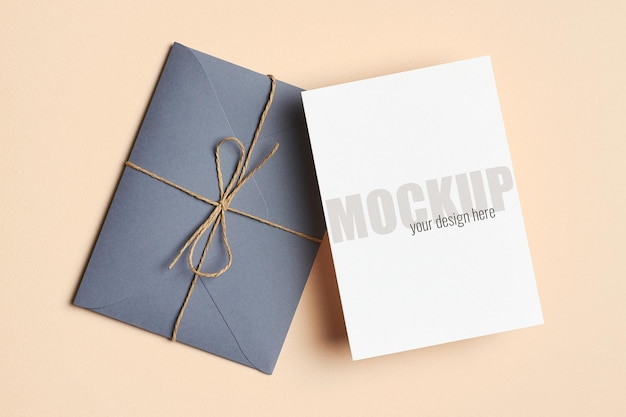 Greeting card or invitation stationary mockup with envelope on paper background