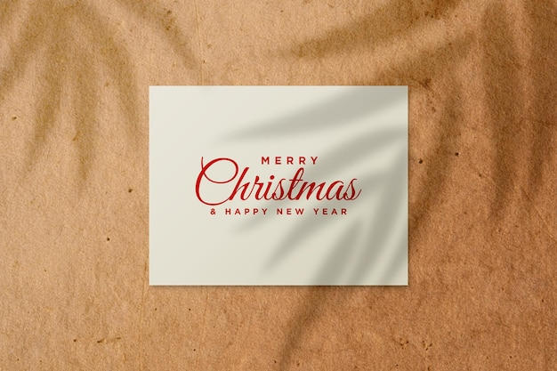 Greeting card mockup with christmas concept with palm leaves shadow