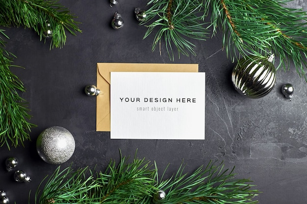 Greeting card mockup with christmas decorations and pine branches on dark