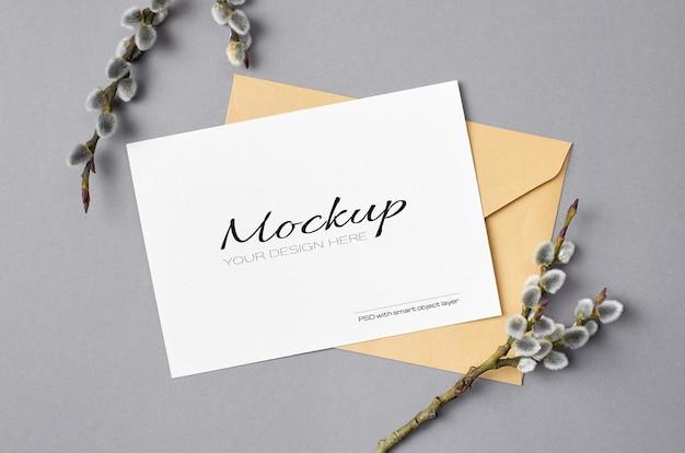Макет поздравительной открытки с конвертом и ветками весенней ивы