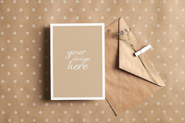 Greeting card mockup with envelope and dry flower