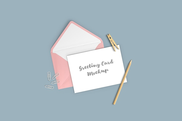 Greeting card mockup with envelope, pencil and clothespin