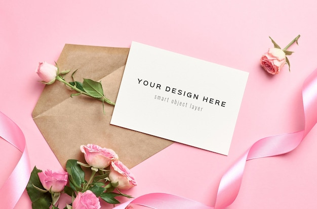 Greeting card mockup with envelope, pink ribbon and roses flowers
