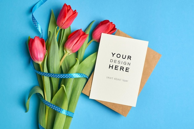 Greeting card mockup with envelope and red tulip flowers bouquet