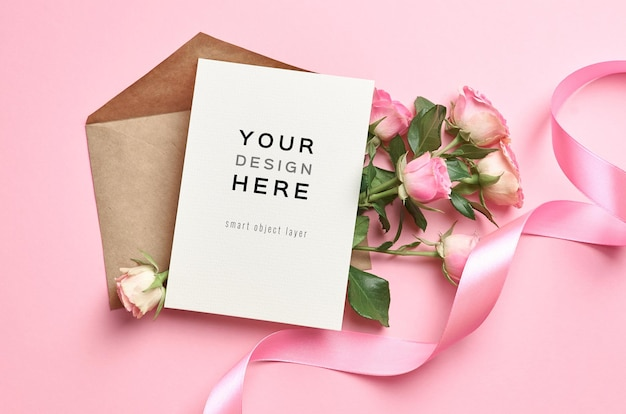 Greeting card mockup with envelope and roses flowers on pink background