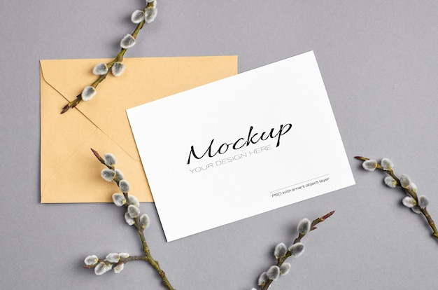 Greeting card mockup with envelope and spring willow twigs on grey