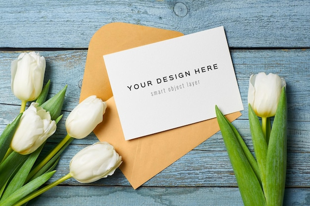 Greeting card mockup with envelope and tulip flowers
