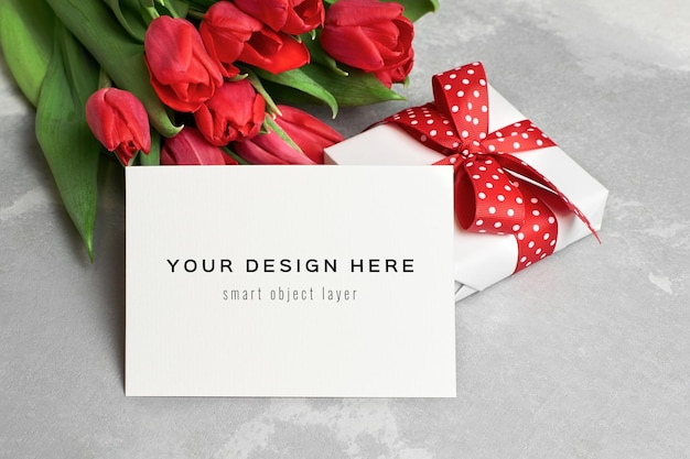 Greeting card mockup with fift box and red tulip flowers bouquet
