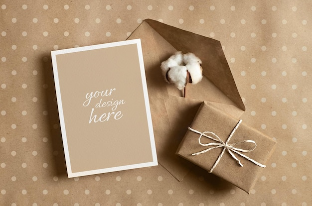 Greeting card mockup with gift box, envelope and cotton flower