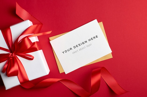 Greeting card mockup with gift box on red background