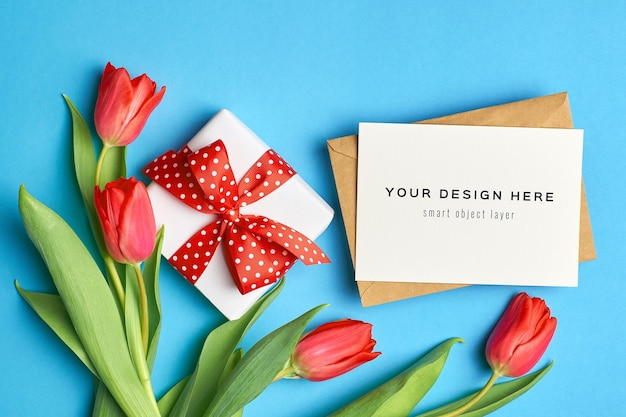 Greeting card mockup with gift box and red tulip flowers