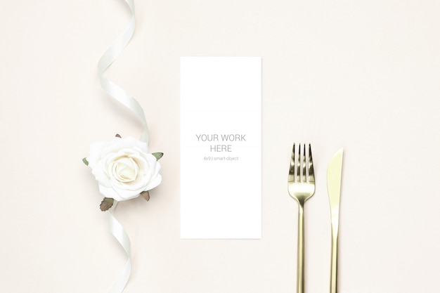 Greeting card mockup with gold cutlery and ribbon