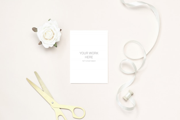 Greeting card mockup with gold scissors and ribbon