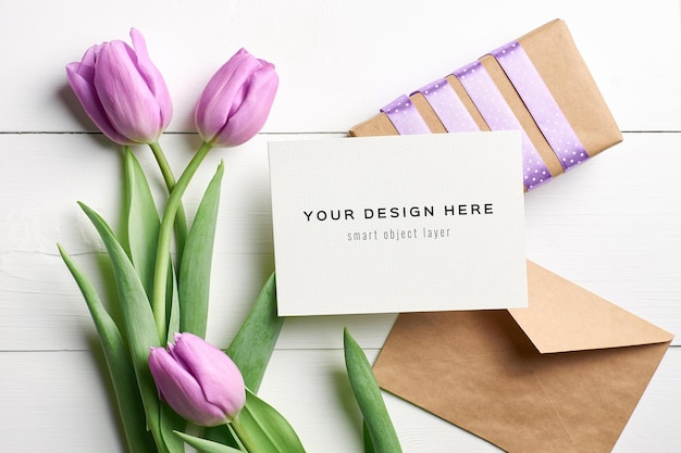 Greeting card mockup with tulip flowers, envelope and gift box
