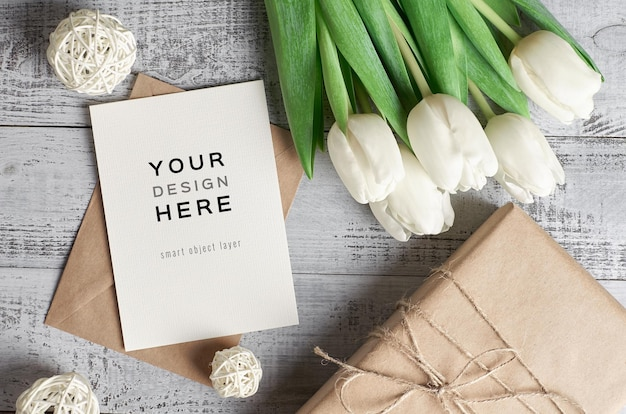 Greeting card mockup with tulip flowers and gift box