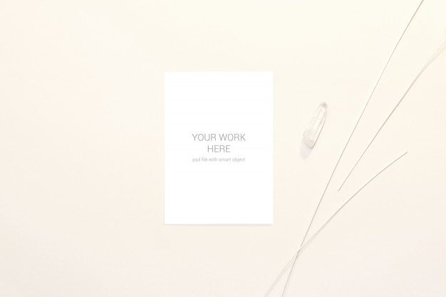 Greeting card mockup with white stone and branches