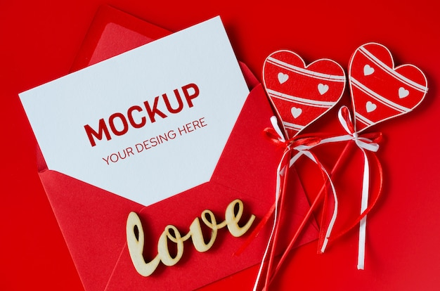 Greeting card for valentine's day. red envelope with blank white paper. mock up of love letter.
