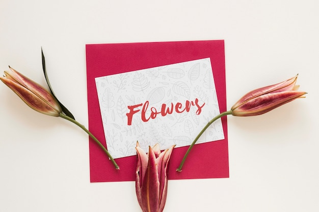Greeting card with blooming flowers on table