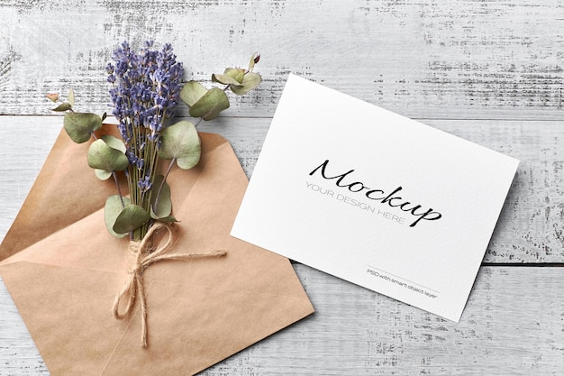Greeting or invitation card mockup with envelope and dry lavender bouquet with eucalyptus