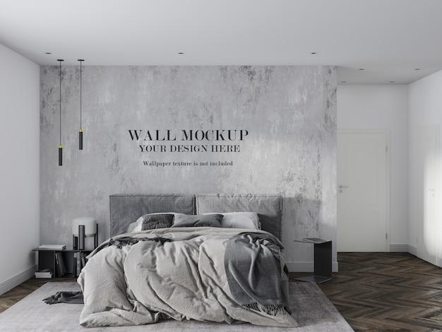 アクセサリー付きの灰色の寝室の壁のモックアップ