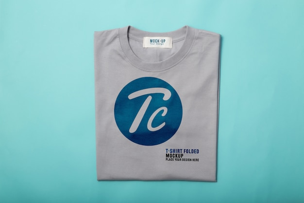 Grey folded t-shirts mockup template for your design on blue background