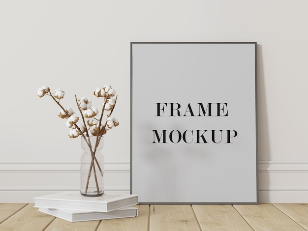 Grey picture frame leaning against white wall