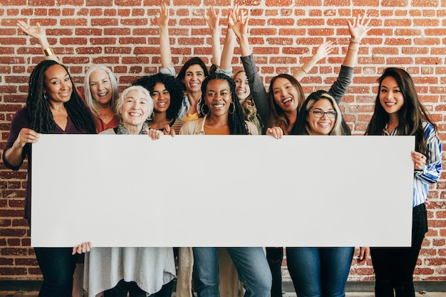 Group of diverse women showing a blank banner mockup