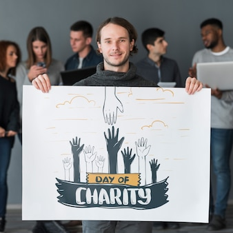 Group of people holding placard mockup for charity