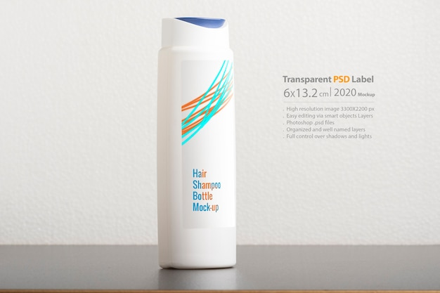 Hair shampoo bottle in front of light gray background