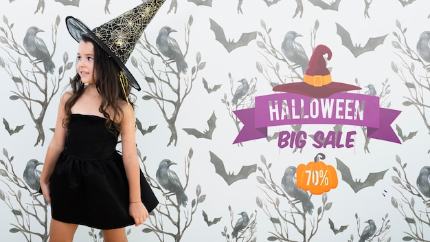Halloween big sale and cute girl dressed as witch