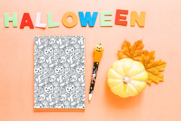 Halloween book cover mockup with pumpkin