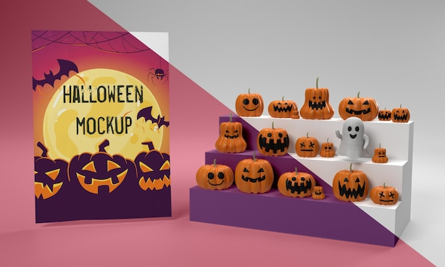 Halloween card mock-up next to scary pumpkins