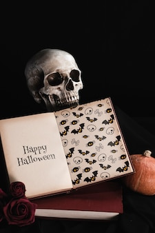 Halloween concept of mock-up book with skull