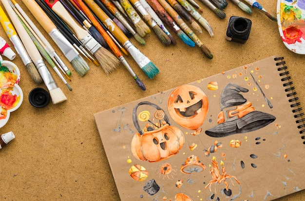Halloween draw on notebook with brushes